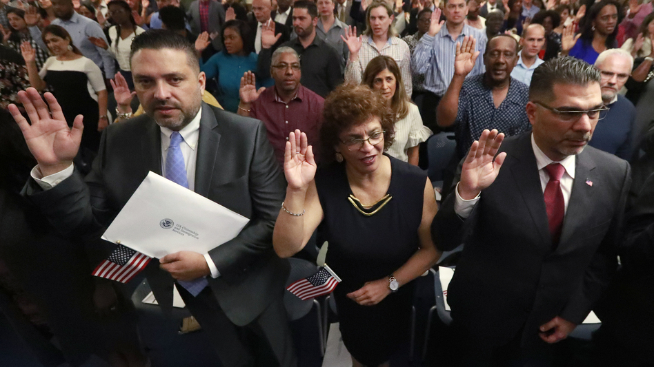 New citizens take the oath of allegiance during a naturalization ceremony in Oakland Park, Fla., earlier this year. The Trump administration has announced there will be changes to the U.S. citizenship test. (Wilfredo Lee/AP)