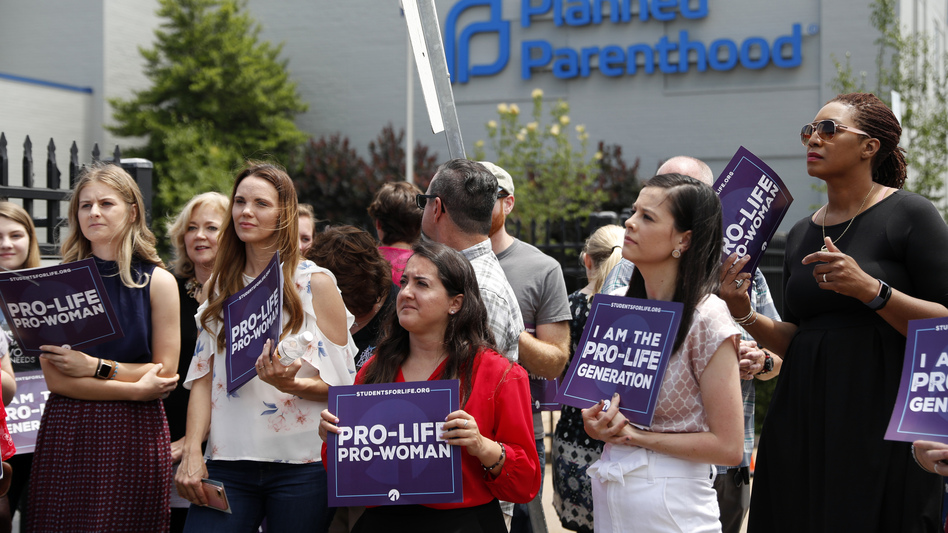 Anti-abortion-rights advocates gather outside a St. Louis Planned Parenthood clinic in June. Title X recipients have been given more time to comply with new regulations. (Jeff Roberson/AP)