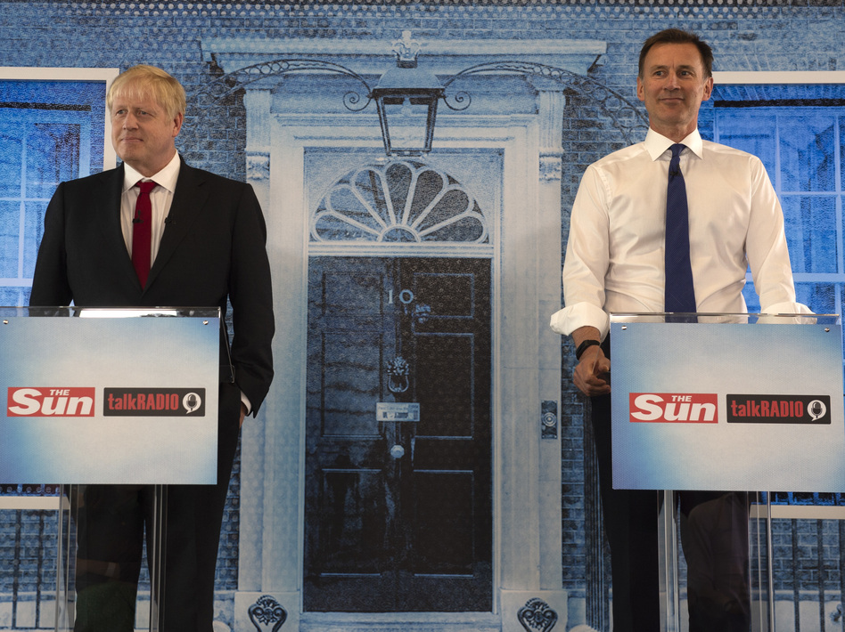 Boris Johnson and Jeremy Hunt debate on July 15 in London. Awaiting the next prime minister will be an international crisis with Iran, stemming from its seizure of a British-flagged commercial oil tanker. (WPA Pool/Getty Images)