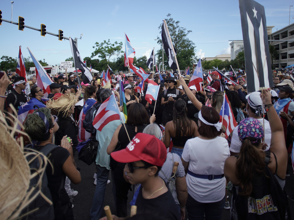People take to the Las Americas Highway in San Juan, Puerto Rico on Monday demanding the resignation of Gov. Ricardo Rosselló. (ERIC ROJAS/AFP/Getty Images)