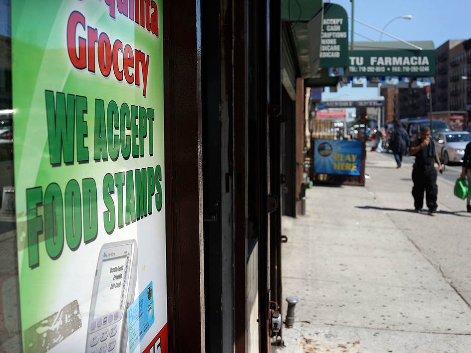 A grocery store in New York City advertises that it accepts food stamps. A Trump administration proposal could result in 3 million people losing their food assistance. (Spencer Platt/Getty Images)