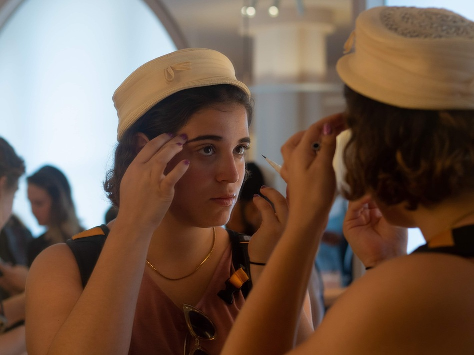 A customer tests an eyebrow pencil in the mirror at the New York City flagship store for the beauty startup Glossier. It's one of the latest companies to become a unicorn, with a market value of $1 billion as of March. (Amy Scott/NPR)