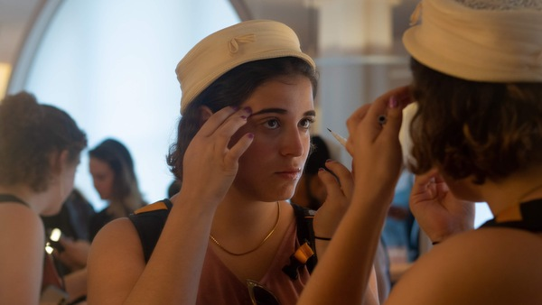 A customer tests an eyebrow pencil in the mirror at the New York City flagship store for the beauty startup Glossier. It