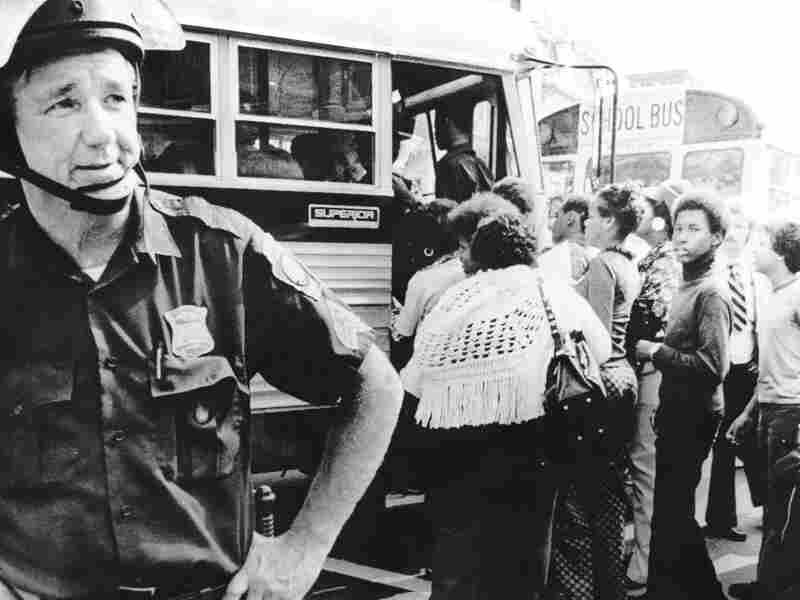 A police on guard as Boston begins a school busing program on September 12, 1974, to integrate Boston Public Schools under a court order.