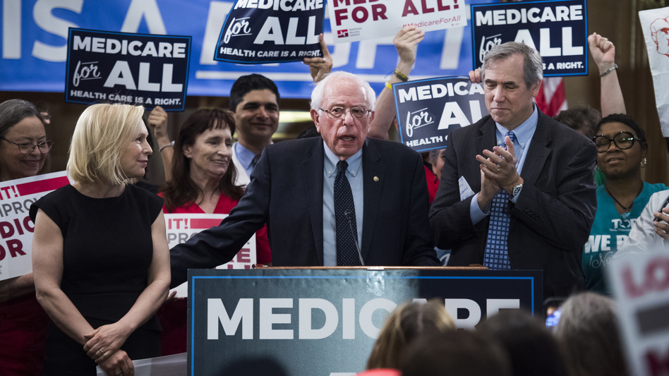 "Sens. Kirsten Gillibrand, Bernie Sanders and Jeff Merkley hold an event to introduce the ""Medicare for All Act of 2019"" near the U.S Capitol in April. (Tom Williams/CQ-Roll Call,Inc.)"