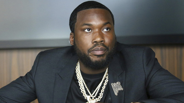 A Pennsylvania appeals court is ordering a new trial for musician Meek Mill, 10 years after he was convicted of drug and weapons crimes. Mill is seen here this week announcing the launch of the Dream Chasers record label, in a joint venture with Jay-Z.