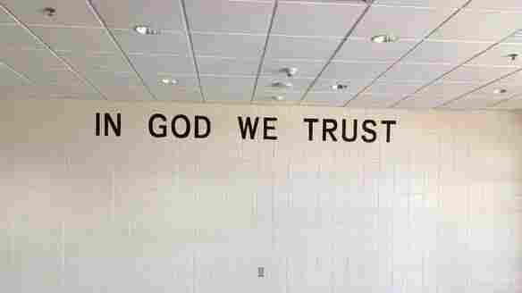 South Dakota Public Schools Add 'In God We Trust' Signs To Walls