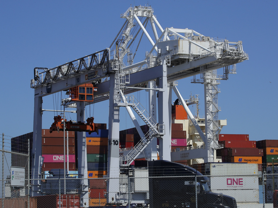 A container ship is unloaded at the Port of Oakland in California. A drop in exports contributed to a slowdown in U.S. economic growth in the second quarter. (Ben Margot/AP)