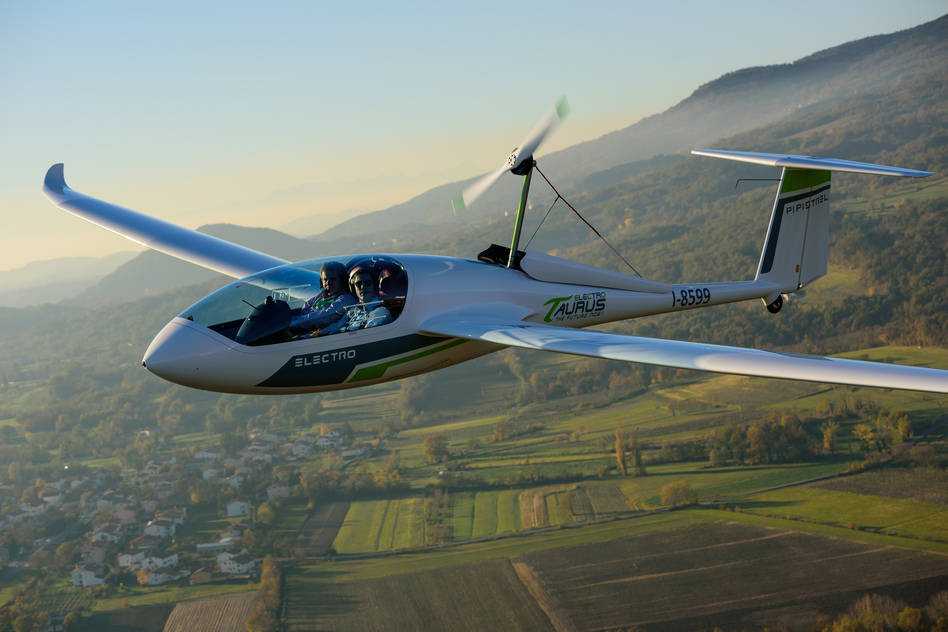 A Pipistrel Taurus Electro electric two-seat airplane flies above Ajdovscina, Slovenia. (Jure Makovec/AFP/Getty Images)