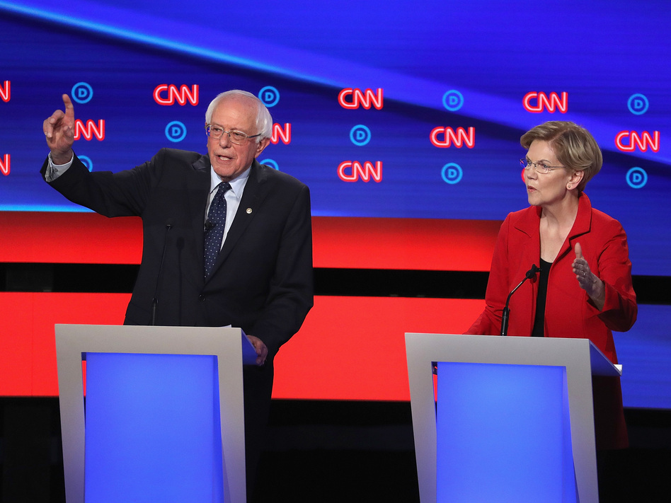 """On the debate stage in Detroit, Sens. Elizabeth Warren and Bernie Sanders were at the center of a heated fight over """"Medicare for All."""" (Justin Sullivan/Getty Images)"""