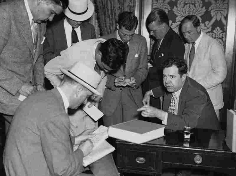US Senator Huey Long (1893 - 1935) announces his presidential candidacy to members of the press, 15th August 1935. A month later, he was shot and killed during an altercation with Dr. Carl Weiss.