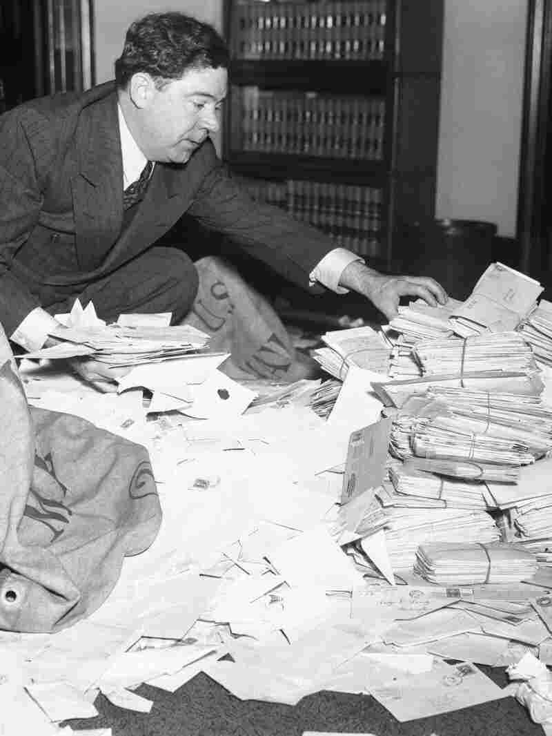 Senator Long sorting through his fan mail that he received after one of his radio broadcasts.
