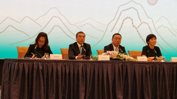 Huawei Chairman Liang Hua (second from left) appears at a news conference to announce earnings results Tuesday in Shenzhen, China.