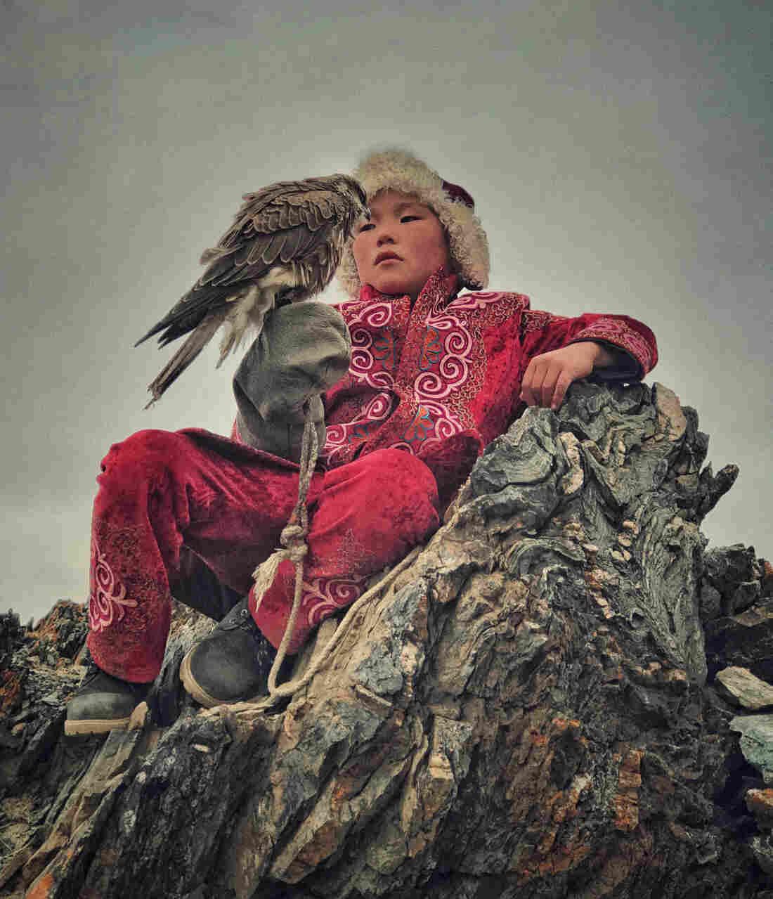 A boy with his hunting bird in Bayan Ulgi province, Mongolia.