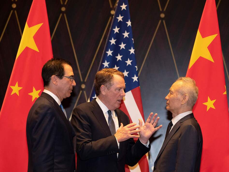 U.S. Treasury Secretary Steven Mnuchin (left) looks on as U.S. Trade Representative Robert Lighthizer speaks with and Chinese Vice Premier Liu He in Shanghai on Wednesday. (Ng Han Guan/AFP/Getty Images)