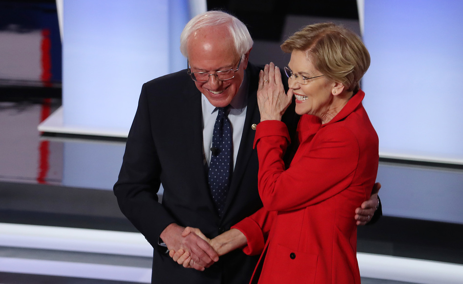 Sanders and Warren greet each other at the start of Tuesday night's debate. (Justin Sullivan/Getty Images)