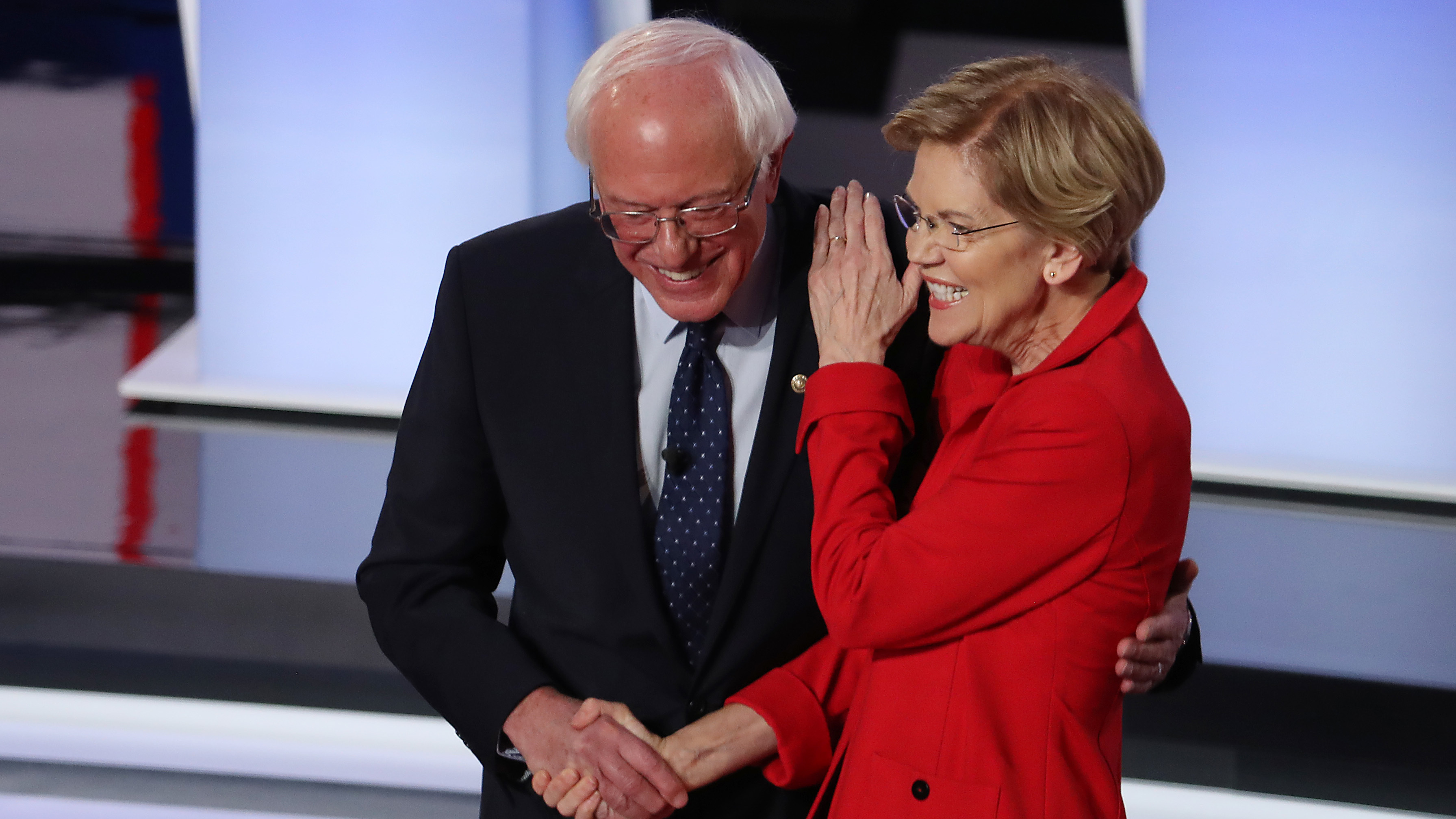 Sanders and Warren greet each other at the start of Tuesday night's debate.
