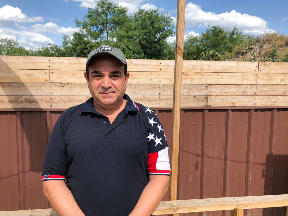 Ross Barrera, Starr County GOP chairman, wants a border wall to stop unauthorized migrants who he says hike up from the Rio Grande on the path behind his fence. (John Burnett/NPR)