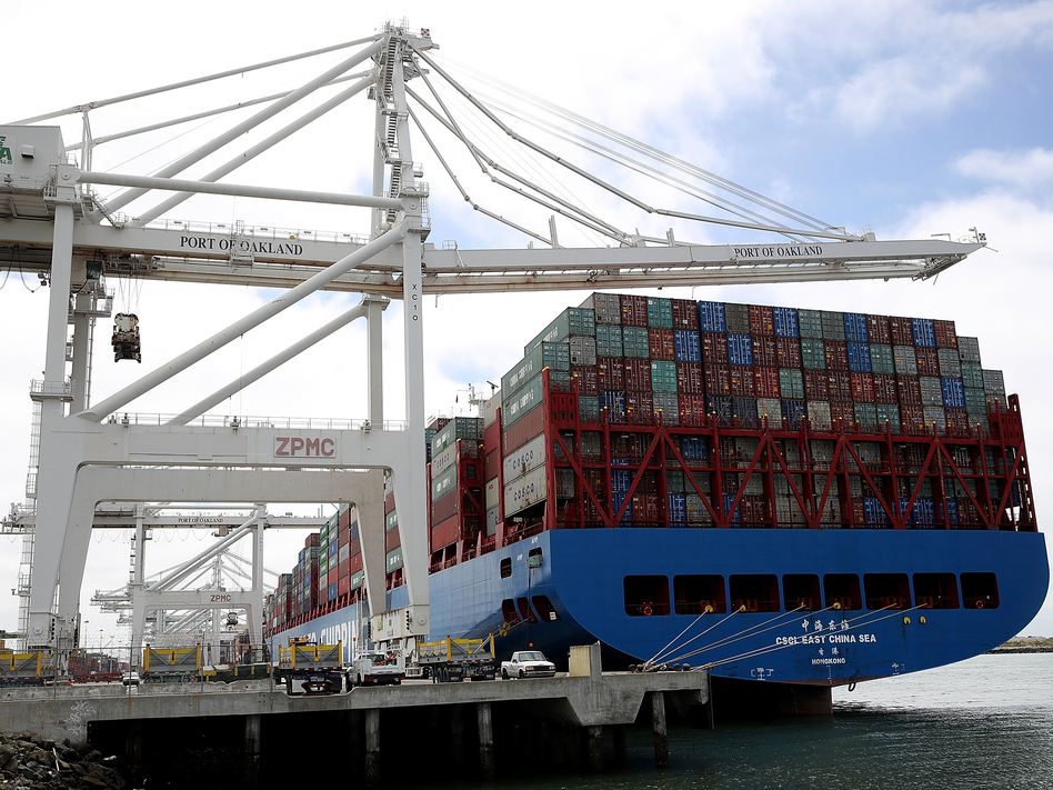 A container ship sits in a berth at the Port of Oakland in California last year. President Trump announced additional tariffs on imports from China on Thursday. (Justin Sullivan/Getty Images)