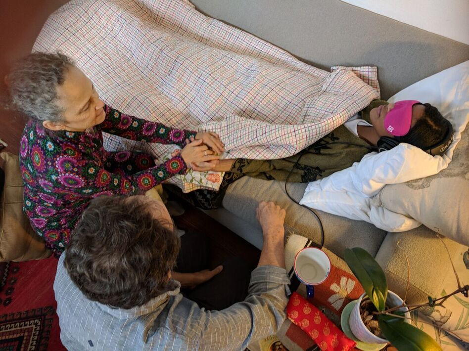 Therapists Marcela Ot'alora and Bruce Poulter are trained to conduct MDMA-assisted psychotherapy. In this reenactment, they demonstrate how they help guide and watch over a patient who is revisiting traumatic memories while under the influence of MDMA. (Courtesy of the Multidisciplinary Association for Psychedelic Studies)