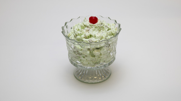 We may think of salads as leafy and green, but the Watergate salad is only the latter. A combination of pistachio pudding mix, canned pineapple, whipped cream and chopped nuts, the salad is the shade of a Shamrock Shake ... sort of a minty chartreuse.
