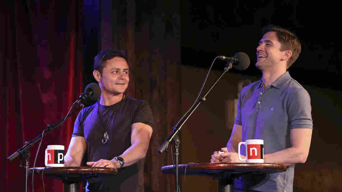 Arturo Castro and Topher Grace face off in a game on Ask Me Another at the Bell House in Brooklyn, New York.