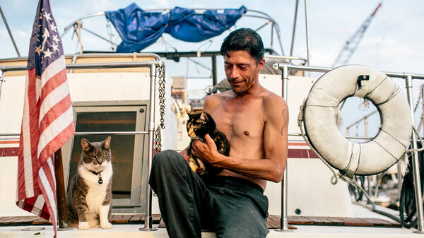 Paul Butler — with his cats, Nelson and Emma, aboard Spiritwood II — moved to Gangplank Marina in Washington, D.C., in 2007.