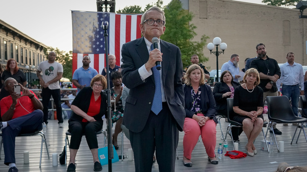 "Ohio Gov. Mike DeWine reacts as people in the crowd repeatedly shout ""Do something!"" during his speech at a vigil following the deadly mass shooting in Dayton."