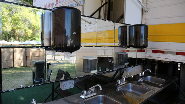 Mobile sinks and showers set up on the Warm Springs Indian Reservation. In May, a burst pipe led to a cascade of infrastructure failures and the reservation has been without safe drinking water all summer.