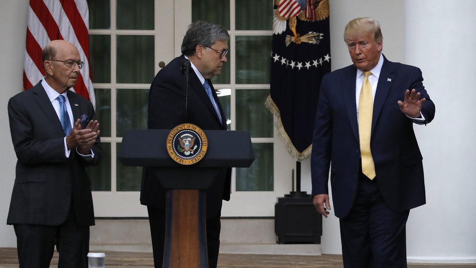 President Trump is joined by Commerce Secretary Wilbur Ross (left) and Attorney General William Barr during a July event at the White House announcing that his administration is relying on federal agency records to produce citizenship data. (Carolyn Kaster/AP)