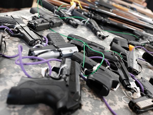Guns for sale at a gun show in Naples, Fla.