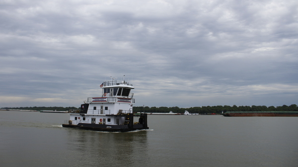 The Shawnee Forest towboat steers down the Ohio River near American Commercial Barge Line