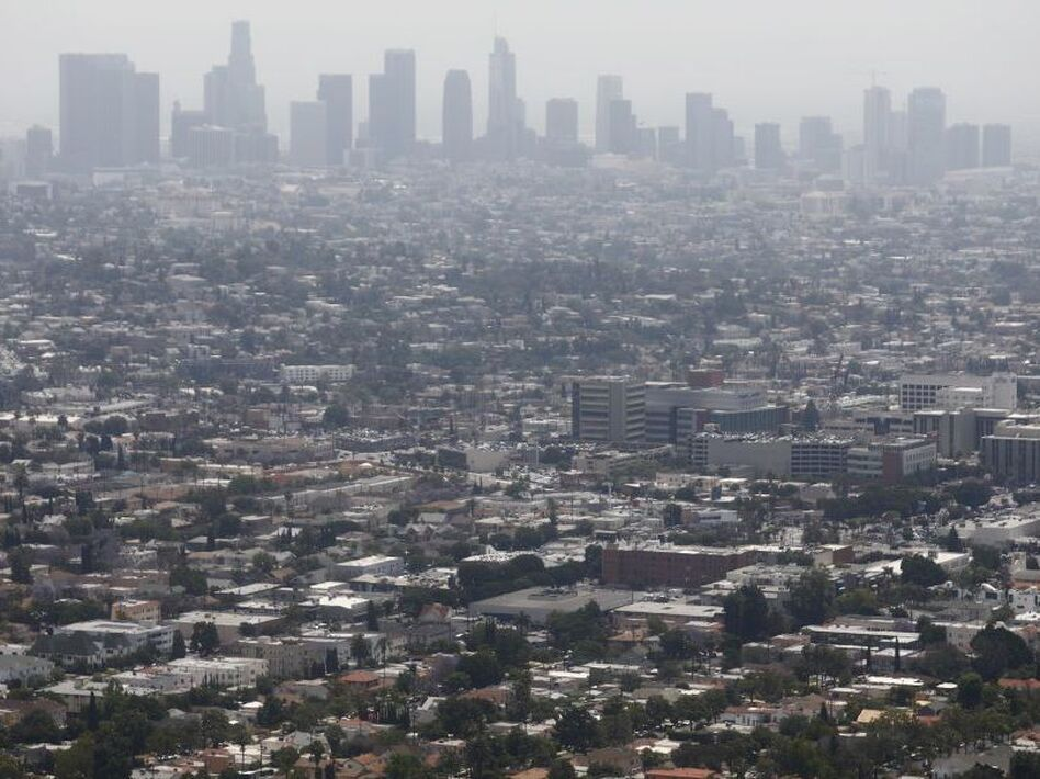 Smog is common not only in Los Angeles but also in cities across the country. New research finds that long-term exposure to high levels of air pollution may be as harmful to the lungs as smoking. (Mario Tama/Getty Images)