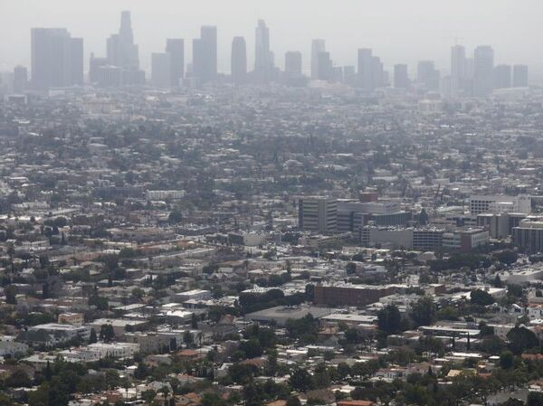 Smog is common in places like Los Angeles, but it also occurs in many cities around the country. New research finds that long-term exposure to high levels of air pollution may be as harmful to the lungs as smoking.