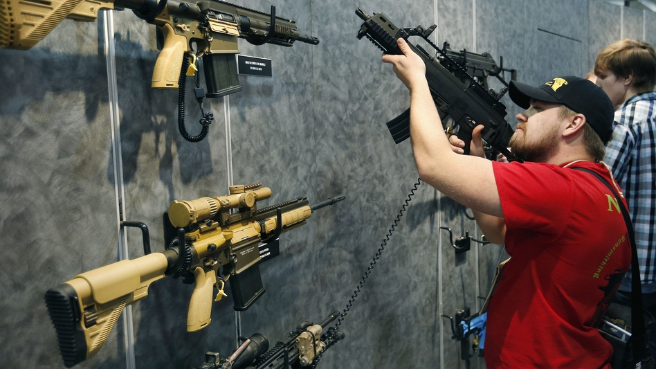 A visitor peruses H&K rifles at the SHOT Show in Las Vegas. Such weapons were once restricted under a 1994 ban that expired with changing politics in the United States. (John Locher/AP)