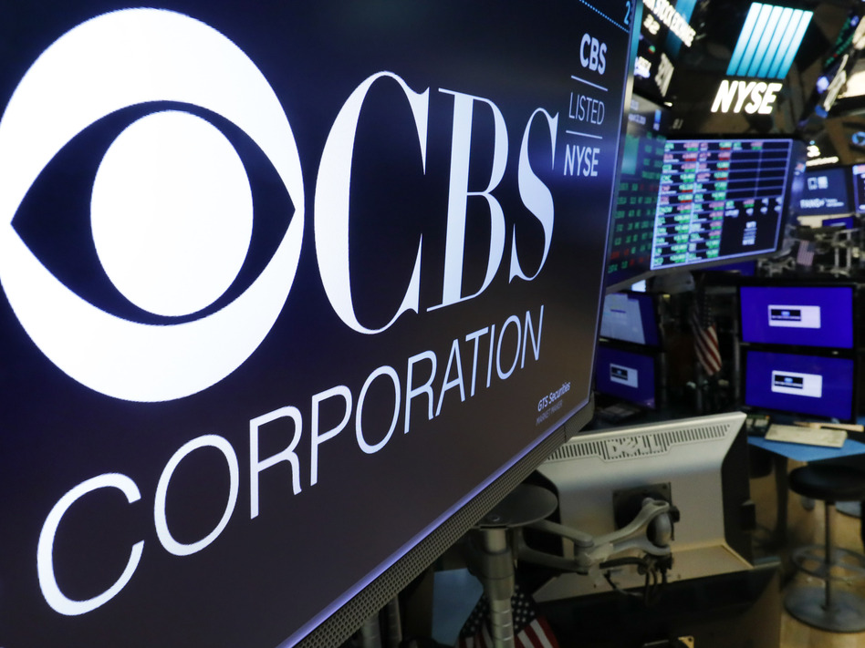 CBS and Viacom said Tuesday they will reunite, bringing together their networks and the Paramount movie studio as traditional media giants bulk up to challenge streaming companies like Netflix. (Richard Drew/AP)
