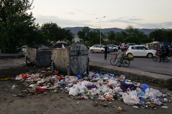 Uncollected trash piles in the streets.