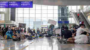 Hong Kong Airport Resumes Operations After Court Injunction Limiting Protests
