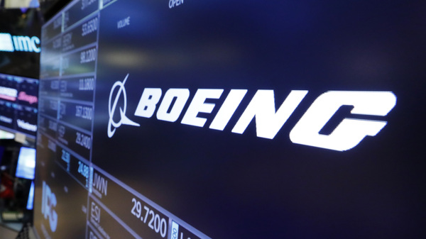 The logo for Boeing appears above a trading post on the floor of the New York Stock Exchange in July.