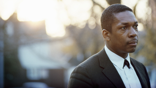 John Coltrane, photographed in his backyard in Queens, New York in 1963.