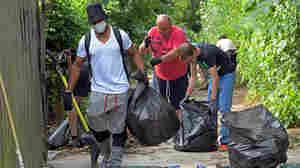 Trump Tweets On 'Disgusting' Baltimore Bring Activist Trash Collectors To City