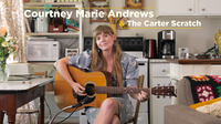 "Courtney Marie Andrews demonstrates how to play the ""Carter scratch"""
