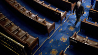 Senate Majority Leader Mitch McConnell of Kentucky walks off the House floor in April. In his chamber, McConnell can decide virtually by himself what the Senate will do — and even what it will consider doing.