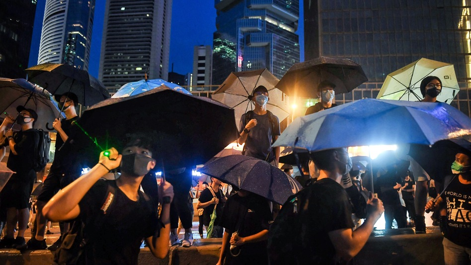 Protesters gather for a rally Sunday in Hong Kong. Many of the pro-democracy demonstrators have brandished umbrellas in a nod to a symbol widely used during the semiautonomous city's massive 2014 protests. (Lillian Suwanrumpha/AFP/Getty Images)