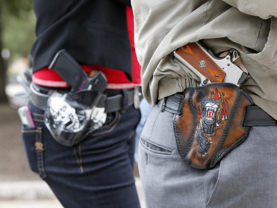 A new survey finds that a majority of Americans, including gun owners, support laws that allow family members or law enforcement to request temporary removal of guns from a person who is seen to be a risk to themselves or others. (Erich Schlegel/Getty Images)