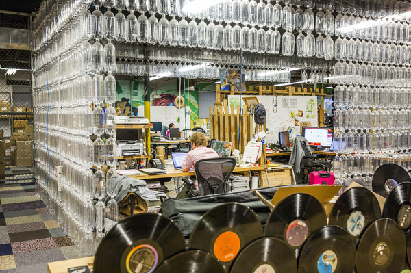 Plastic bottles surround an employee at a work station inside recycling company TerraCycle's headquarters in Trenton, N.J., in 2017.