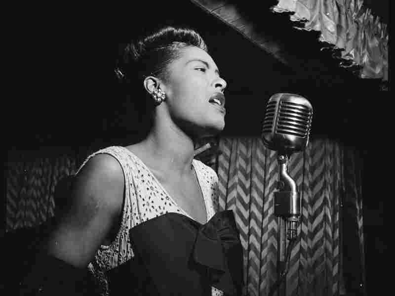 Portrait of Billie Holiday singing at the Downbeat club in New York City on February 1947.