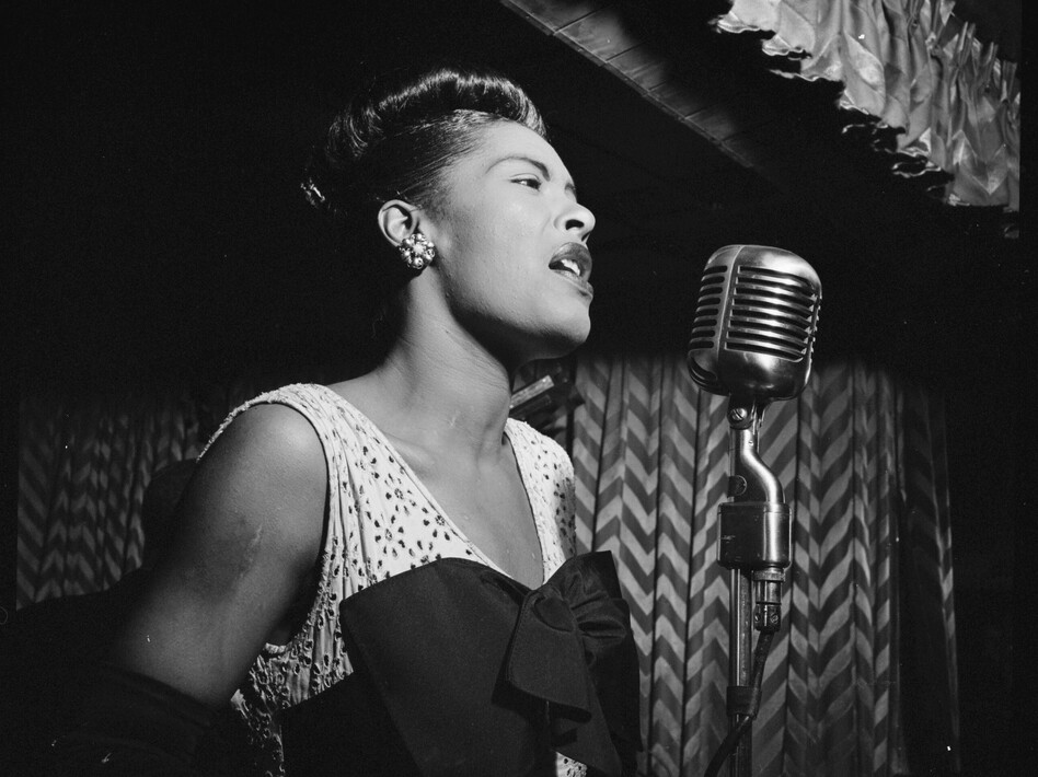 Portrait of Billie Holiday singing at the Downbeat club in New York City on February 1947. (Library of Congress)