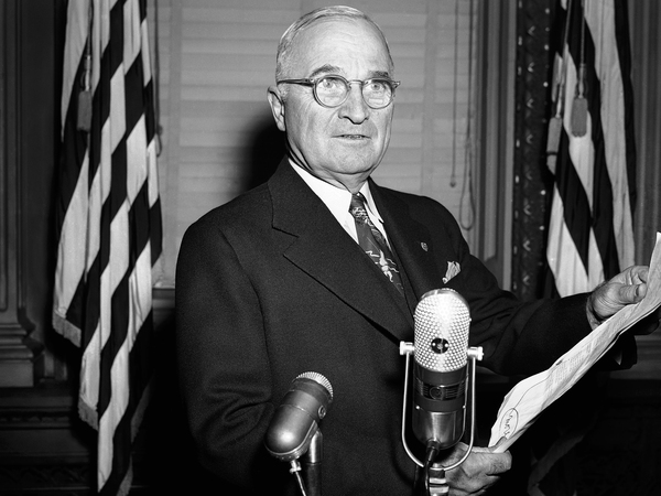 President Harry Truman read a statement to reporters in the White House. His administration secretly negotiated use of sites in Greenland during the Cold War, including a prospective sale.
