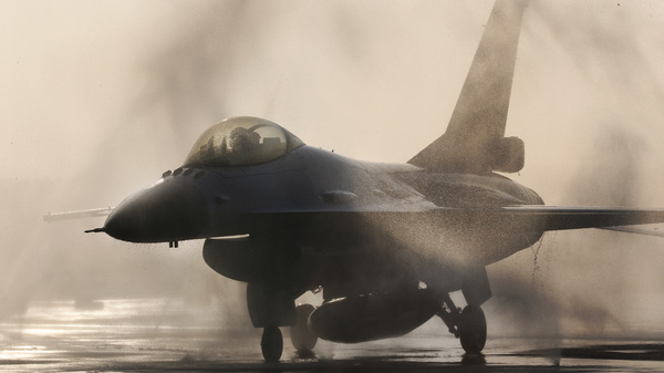 An F-16 jet fighter is washed on the tarmac at an air force base in Taiwan. The State Department has approved the sale of 66 fighter jets to the island.